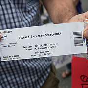 A man with an unused ticket shows his event ticket as protestors gather in the staging site prior to a Richard Spencer speech at the Phillips Center for the Performing Arts on the University of Florida campus in Gainesville, Florida on Thursday, October 18, 2017. (Alex Menendez)