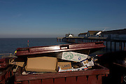 Piled rubbish in a waste skip near the pier at the Suffolk seaside town of Southwold, Suffolk.