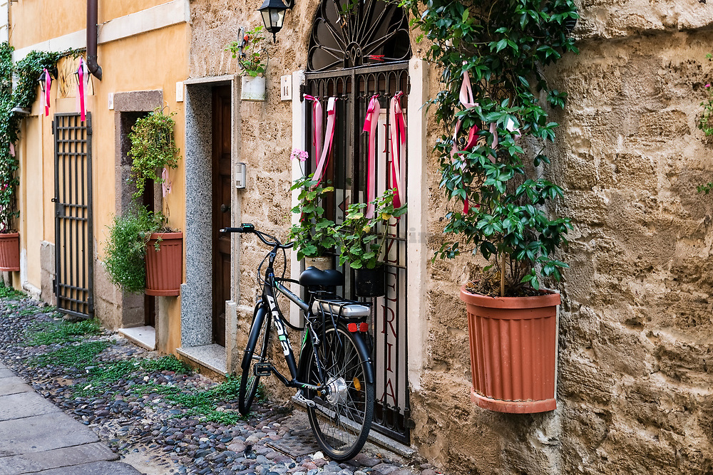 Charming street with bike, Alghero, Sardinia, Italy