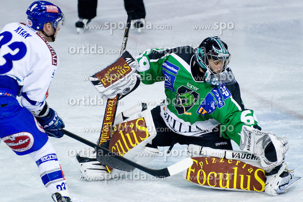 Matija Pintaric (HDD Tilia Olimpija, #69) vs Matthew Ryan (EC Rekord-Fenster VSV, #23) during ice-hockey match between HDD Tilia Olimpija and EC Rekord-Fenster VSV in 46th Round of EBEL league, on Februar 6, 2011 at Hala Tivoli, Ljubljana, Slovenia. (Photo By Matic Klansek Velej / Sportida.com)