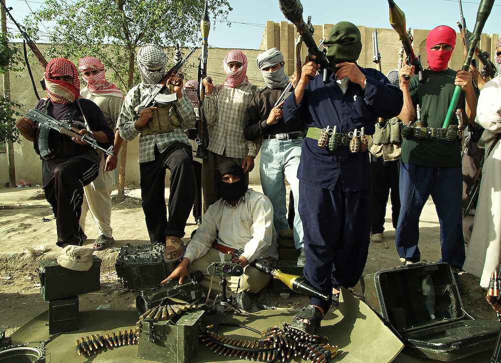 Members of Moqtada al-Sadr's Mehdi Army display their weapons and some equipment captured from US forces in Kufa, Iraq on the 7th May 2004.