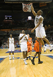 Georgia Tech forward Jeremis Smith (32) dunks against Virginia.  The Virginia Cavaliers faced the Georgia Tech Yellow Jackets in the first round of the 2008 ACC Men's Basketball Tournament at the Charlotte Bobcats Arena in Charlotte, NC on March 13, 2008.