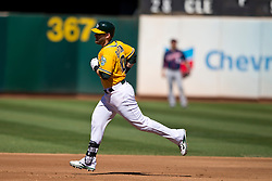 OAKLAND, CA - SEPTEMBER 22: Daric Barton #10 of the Oakland Athletics rounds the bases after hitting a home run against the Minnesota Twins during the third inning at O.co Coliseum on September 22, 2013 in Oakland, California. The Oakland Athletics defeated the Minnesota Twins 11-7 as they clinched the American League West Division. (Photo by Jason O. Watson/Getty Images) *** Local Caption *** Daric Barton
