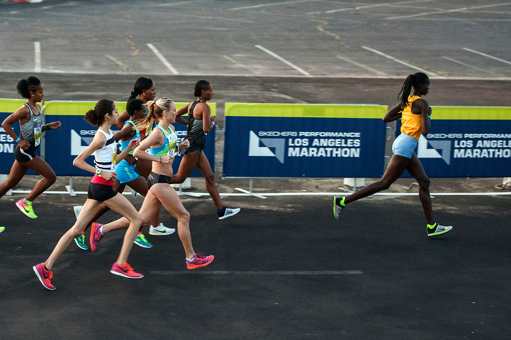 """Winner Hellen Jepkurgat, right, takes an early lead of the pack of women runners at the start of the 32nd annual Los Angeles Marathon at Dodger Stadium on Sunday morning, March 19, 2017 in Los Angeles, Calif.  The 26.2-mile """"Stadium to the Sea"""" route begins at Dodger Stadium and ends at Ocean and California avenues in Santa Monica. © 2017 Patrick T. Fallon"""