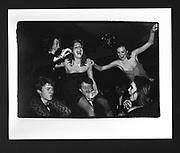 Tamara Yeardye on Alexander Kasterine, Cordelia Hart on Paddy Turner and Cathy Kasterine above Charlotte Holt at the Bobbin Ball. Empire Rooms, 21 December 1983