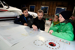 NORWAY BARENTS SEA 6DEC15 - Greenpeace campaigners Larissa Baeumer of Germany and Erlend Tellnes (L) of Norway prepare for the surveys flight to the production platform Goliat in the Barents Sea operated by Italian energy compay Eni. It is the world's most northerly oil production platform.<br /> <br /> jre/Photo by Jiri Rezac / Greenpeace<br /> <br /> © Jiri Rezac 2015