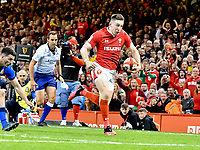 Rugby Union - 2020 Six Nations Championship - Wales vs. Italy<br /> <br /> Josh Adams of Wales breaks to score , at the Principality (Millennium) Stadium.<br /> <br /> COLORSPORT/WINSTON BYNORTH