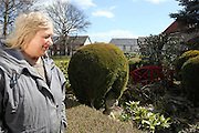 A prefab owner, proudly showing her prefab garden, Old Bramton, Chesterfied