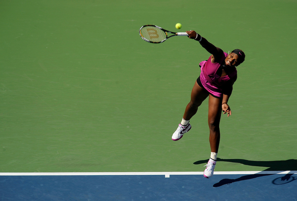 NEW YORK - SEPTEMBER 04: Serena Williams serves to Maria Jose Martinez Sanchez during day five of the 2009 U.S. Open at the USTA Billie Jean King National Tennis Center on September 4, 2009 in Flushing neighborhood of the Queens borough of New York City. (Photo by Rob Tringali) *** Local Caption *** Serena Williams