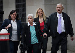 © Licensed to London News Pictures. 23/11/2016. London, UK. Family of murdered MP arrive at the Old Bailey. Jo Cox's parents Gordon (R) and Jean Leadbeater, walk with Jo's sister Kim (2L) and her partner Claire. Defendant Thomas Mair chose not to give any evidence in his defence.  Mair allegedly shot and stabbed the 41-year-old Member of Parliament outside her constituency surgery in Birstall, near Leeds, Yorkshire on June 16 this year. Photo credit: Peter Macdiarmid/LNP
