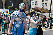 Brooklyn, NY - 18 June 2016. A merman and mermaid in blue.