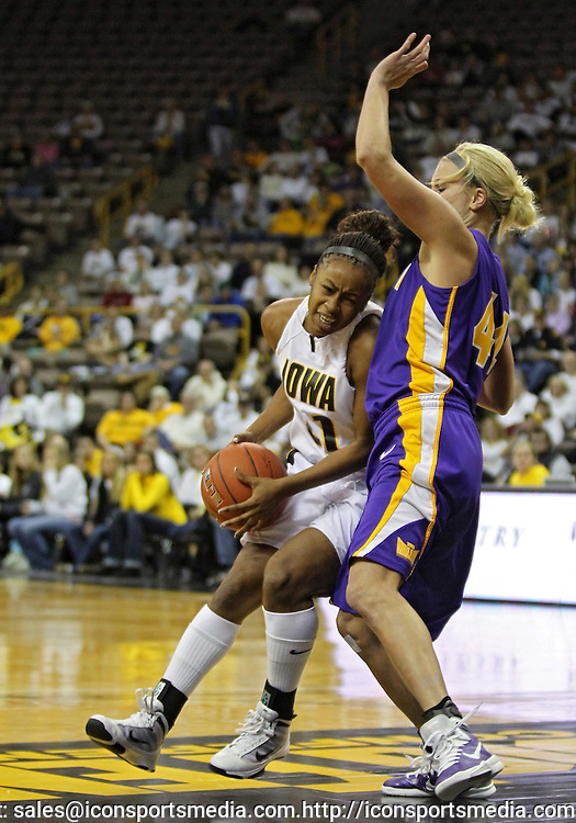 December 22 2010: Iowa guard Kachine Alexander (21) works against Northern Iowa guard/forward Erin Brocka (44) during the first half of an NCAA college basketball game at Carver-Hawkeye Arena in Iowa City, Iowa on December 22, 2010. Iowa defeated Northern Iowa 75-64.