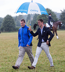 Image ©Licensed to i-Images Picture Agency. 02/08/2014. , United Kingdom.Peter Phillps and a friend braves the rain at theFestival of British Eventing. Gatcombe. Picture by i-Images