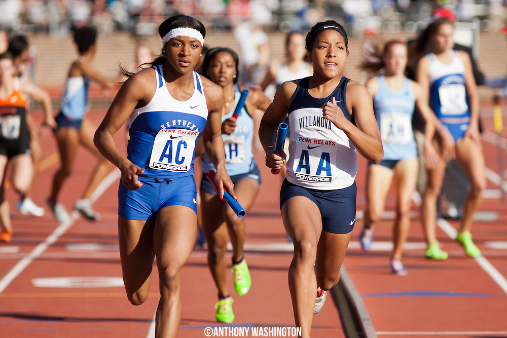 Morganne Phillips of the University of Kentucky and Michaela Wilkins of Villanova University compete in the College Women's Distance Medley Championship of America at the 119th Penn Relays on Thursday, April 25, 2013 in Philadelphia, PA.