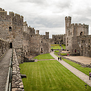 The courtyard at Caernarfon Castle in northwest Wales. A castle originally stood on the site dating back to the late 11th century, but in the late 13th century King Edward I commissioned a new structure that stands to this day. It has distinctive towers and is one of the best preserved of the series of castles Edward I commissioned.