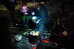 NO WEB/NO APPS - Exclusive. (Text available) A mother is cooking dinner for her family outside her house, in 'Palma Real' native community, near Puerto Maldonado, Peru on July 17, 2017. The Amazon rainforest is famous as 'The Lung of the Earth', but also for the presence of numerous native communities, who have always lived isolated and in close contact with nature for generations, used to seek for food and medicines and to build items directly from the environment in which they live. The unstoppable rise of globalization has drastically changed their needs, expectations and consequently their way of life. Located in the Tambopata National Reserve, on the border between Peru and Bolivia, the native Comunidad Palma Real is one of the clearest examples of this change. Living on the banks of the Madre de Dios River since approximately 1976, Palma Real comprises about 300 people part of the nomadic community Ese-Eja, established in the Amazon rainforest of Peru before the Spanish colonization. Photo by Giacomo d'Orlando/ABACAPRESS.COM