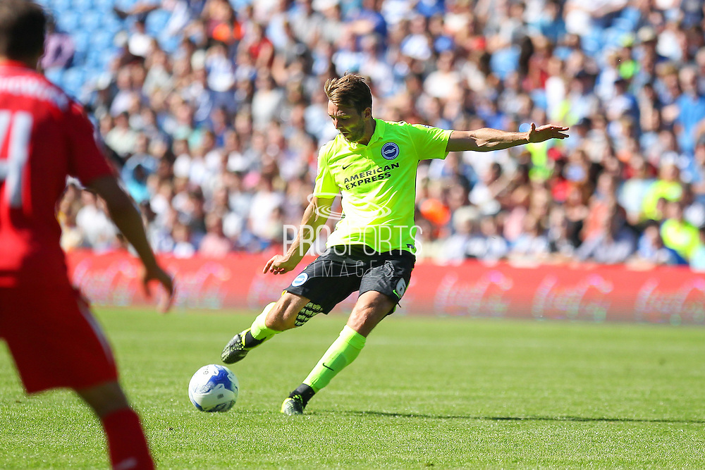 Dale Stephens of Brighton & Hove Albion shoots at goal during the Pre-Season Friendly match between Brighton and Hove Albion and Sevilla at the American Express Community Stadium, Brighton and Hove, England on 2 August 2015. Photo by Phil Duncan.