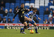Bolton Wanderers midfielder, Liam Feeney (7) and Brighton defender, full back, Inigo Calderon (14) during the Sky Bet Championship match between Brighton and Hove Albion and Bolton Wanderers at the American Express Community Stadium, Brighton and Hove, England on 13 February 2016.