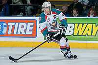 KELOWNA, CANADA -FEBRUARY 10: Madison Bowey #4 of the Kelowna Rockets skates with the puck against the Seattle Thunderbirds on February 10, 2014 at Prospera Place in Kelowna, British Columbia, Canada.   (Photo by Marissa Baecker/Getty Images)  *** Local Caption *** Madison Bowey;