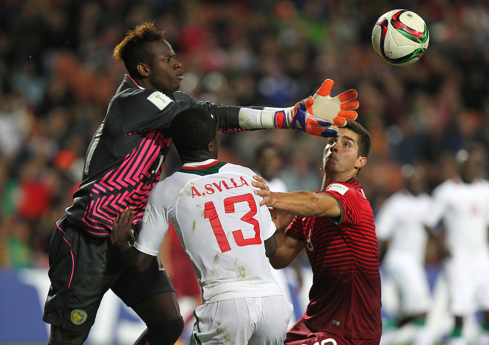 Goal keeper Ibrahima Sy of Senegal jumps over team mate Alhassane Sylla (13) and Andre Silva of Portugal in the group c game of the FIFA u20 World Cup at Waikato Stadium, Hamilton, New Zealand, Sunday, May 31, 2015. Credit:SNPA / Ben Campbell