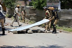 May 19, 2017 - Anantnag, Jammu and Kashmir, India - Policeman Clears roads blocked by Stone pelters during clashes with Security forces after Friday Prayers in Anantnag. (Credit Image: © Muneeb Ul Islam/Pacific Press via ZUMA Wire)