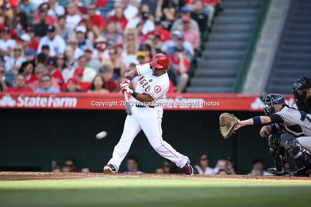 ANAHEIM, CA - JUNE 15:  Alberto Callaspo #6 of the Los Angeles Angels of Anaheim hits a single that puts runners at first and second base in the bottom of the 4th inning during the game against the New York Yankees on Saturday, June 15, 2013 at Angel Stadium in Anaheim, California. The Angels won the game 6-2. (Photo by Paul Spinelli/MLB Photos via Getty Images) *** Local Caption *** Alberto Callaspo