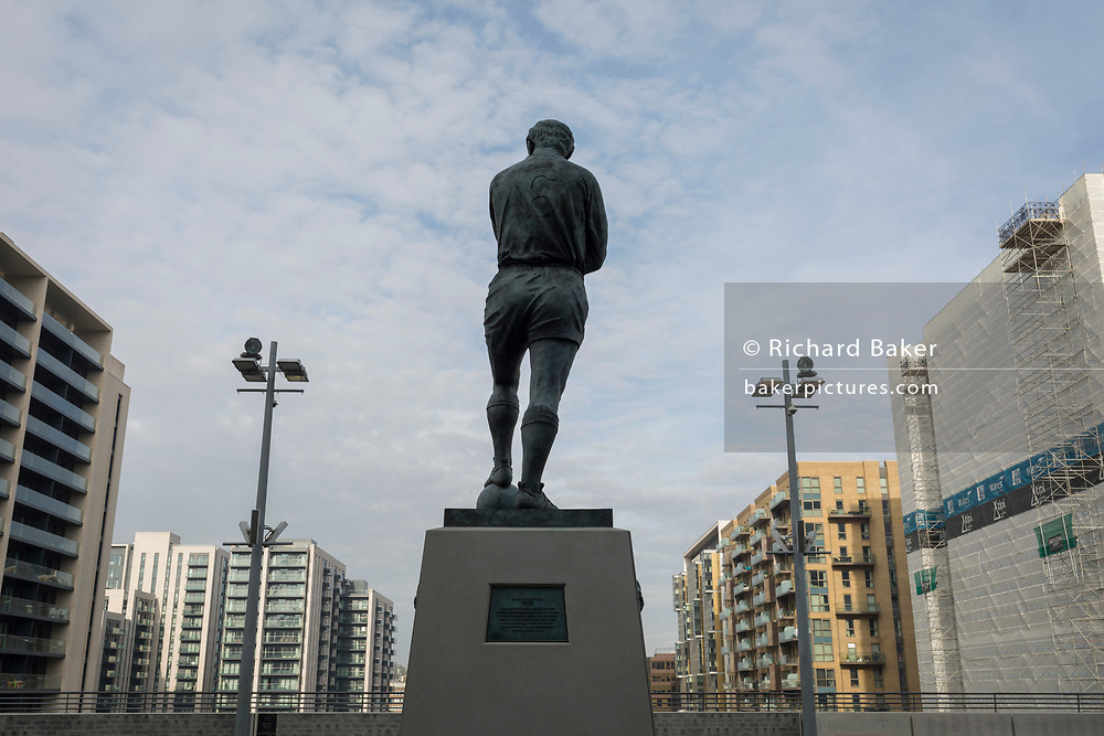 A landscape of regeneration around the Wembley Stadium arena where new properties tower over the statue of English football's most loved player, Bobby Moore, on 6th November 2019, in Wembley, London, England. Sir Bobby Moore captained England to its World Cup victory against Germany at the old Wembley stadium in 1966.