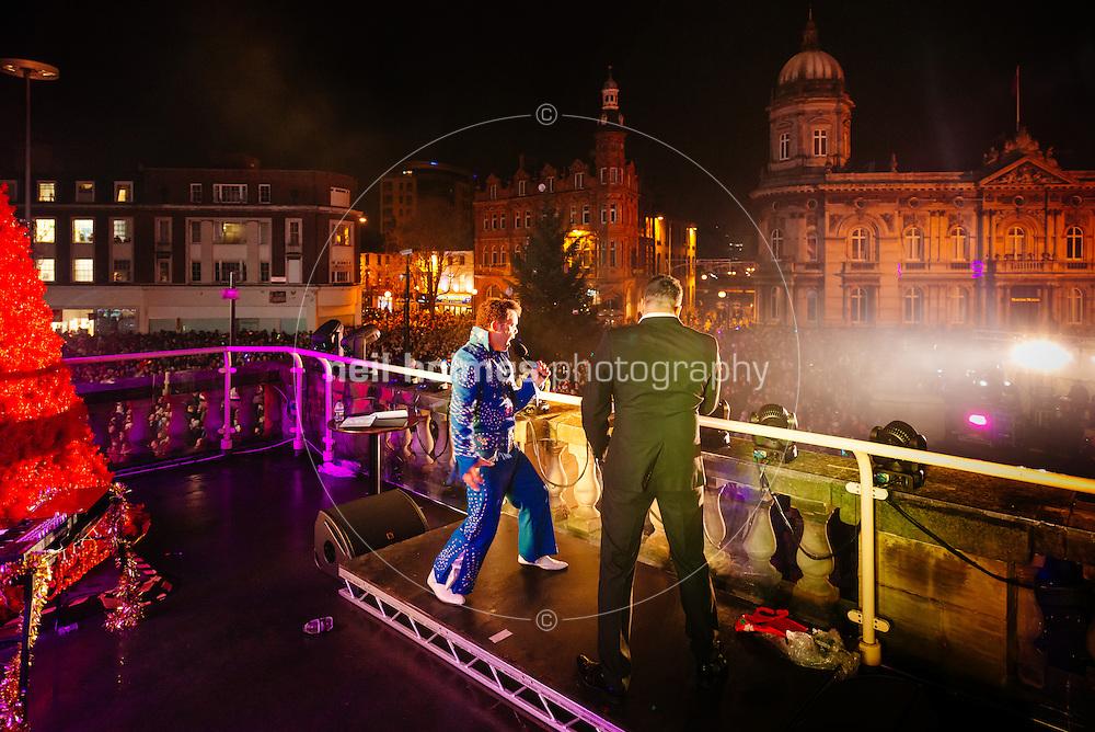 Hull City Centre, Kingston Upon Hull, East Yorkshire, United Kingdom, 27 November, 2014. Christmas Lights Turn On Pictured: Bobby Diamond Elvis impersonator
