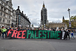 "© Licensed to London News Pictures. 04/11/2017. London, UK.  Demonstrators take part in ""Justice Now: Make It Right For Palestine"", a march from Grosvenor Square to a rally in Parliament Square, demanding justice and equal rights for Palestinians on the centenary of the Balfour Declaration.  Photo credit: Stephen Chung/LNP"