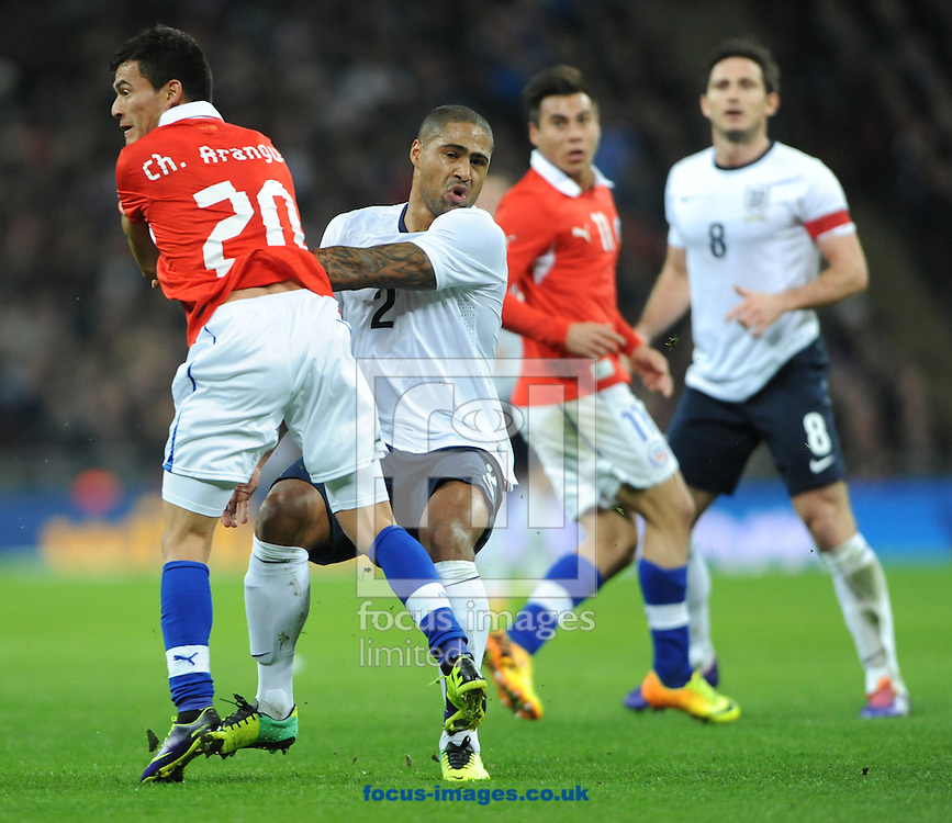 Picture by Daniel Hambury/Focus Images Ltd +44 7813 022858<br /> 15/11/2013<br /> Glen Johnson of England and Charles Aranguiz of Chile during the Friendly match at Wembley Stadium, London.