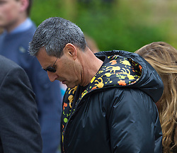 © London News Pictures. 08/06/2012. Thame, UK.  Uri Geller arriving at  St Mary's Church in Thame, Oxfordshire for the funeral of former Bee Gee Robin Gibb on June 8, 2012. Robin Gibb died on May 20, 2012 aged 62 following a long battle against cancer. Photo credit: Ben Cawthra/LNP