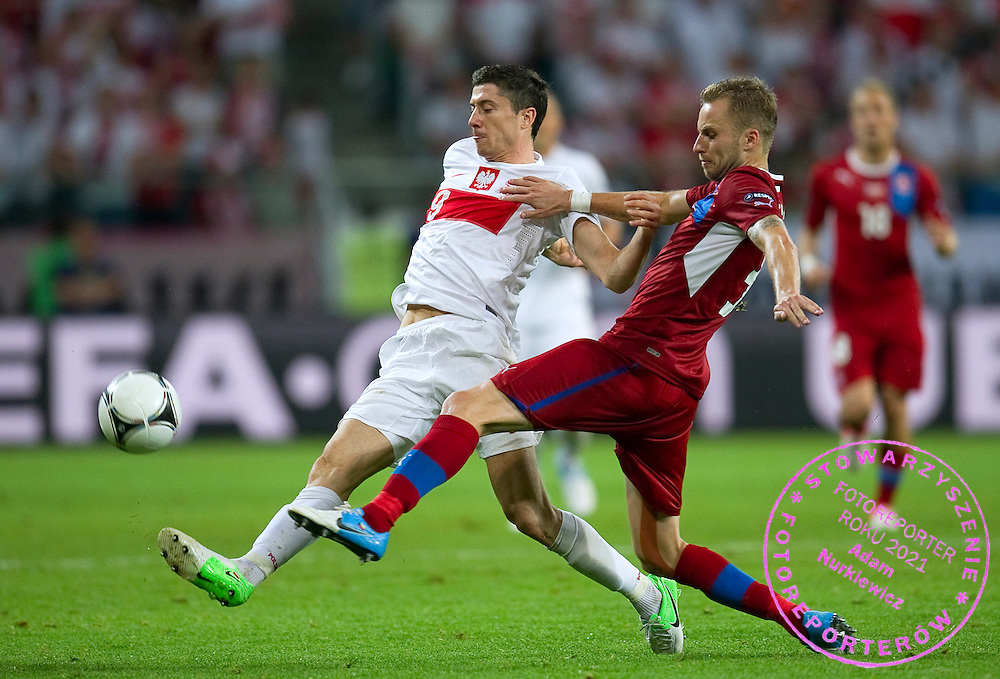 (L) Poland's Robert Lewandowski (nr09) fights for the ball with (R) Czech's Michal Kadlec (nr03) during the UEFA EURO 2012 Group A football match between Poland and Czech Republic at Municipal Stadium in Wroclaw on June 16, 2012...Poland, Wroclaw, June 16, 2012..Picture also available in RAW (NEF) or TIFF format on special request...For editorial use only. Any commercial or promotional use requires permission...Photo by © Adam Nurkiewicz / Mediasport