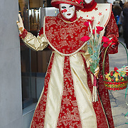 VENICE, ITALY - FEBRUARY 26:  Two women wearing Carnival costumes and masks pose near St Mark Square on February 26, 2011 in Venice, Italy.  The Venice Carnival, one of the largest and most important in Italy, attracts thousands of people from around the world each year. The  theme for this year's carnival is 'Ottocento', a nineteenth century evocation, and will run from February 19 till March 8.