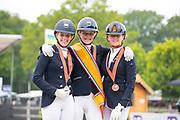 Podium Children 1. Lara van Nek - Amazing Comeback, 2. Anniek van Dulst - Isala's Arielle, 3. Senna Evers - Happy Feet<br /> NK Dressuur 2019<br /> © DigiShots
