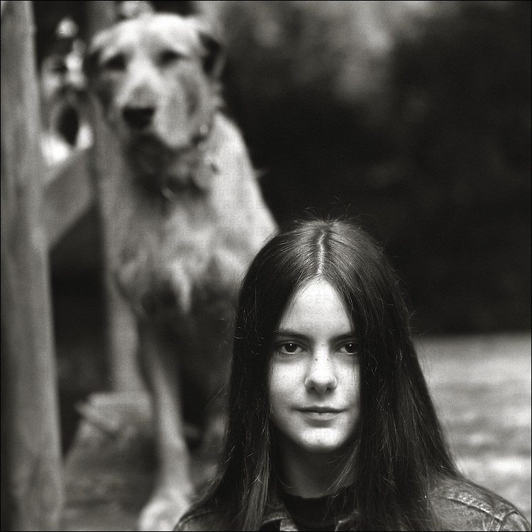 A young woman with her pet dog