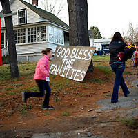 A family returns to their home located very near the site of the  shooting of 20 children and 7 adults at Sandy Hook Elementary School, in Sandy Hook, CT on December 15, 2012.