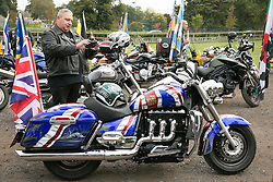 "© Licensed to London News Pictures. 3/10/2015, Tamworth, Staffordshire, UK. The eighth Ride to the Wall ""RTTW"" took place today with thousands of motorcyclists arriving at the National Memorial Arboretum. Starting at eleven designated points around the country, the riders came from all over the UK as well as continental Europe.They rode to visit the walls of the Armed Forces Memorial where the names of 16,000 service men and women are engraved to remember those killed on duty or by terrorist action since the end of the Second World War. A display by the white helmets, tiger moth flypast and memorial service formed part of the day. Riders assembling at Drayton Manor Park before the ride to the NMA. Photo credit / Dave Warren/LNP"