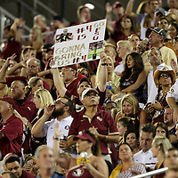 A fan holds up a sign about Dalvin Cook during an NCAA football game between the Ole Miss Rebels and the Florida State Seminoles at Camping World Stadium on September 5, 2016 in Orlando, Florida. (Alex Menendez via AP)