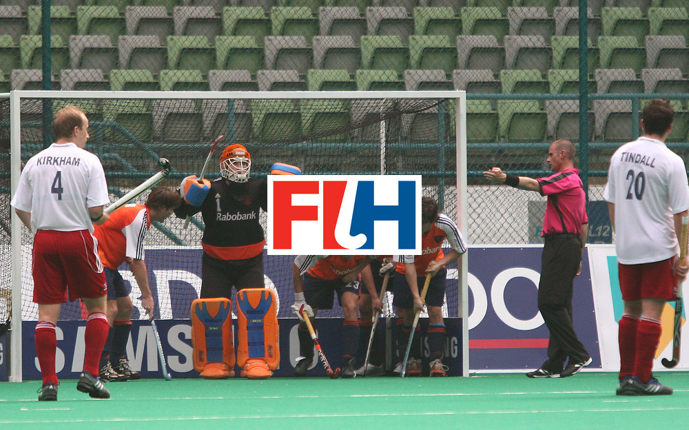 Kuala Lumpur: Great Britain failed to score through the penalty corner against Netherlands in the Samsung Hockey Men Champions Trophy at the National Stadium, Bukit Jalil, Kaula lumpur, Malaysia on Nov 29, 2007.  <br /> Netherlands beat Great Britain 4-0, and the scorers for the winners were Teun de Nooijer, Ronald Brouwer and Rob Reckers(2). The goals came in the 2nd, 40th, 50th and 64th minute respectively and all were field goals. <br />  Photo:GNN/Vino John