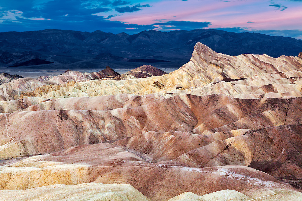 Zabriskie Point 7:33 AM. The unusual eroding patterns are filled with sediment from Furnace Creek Lake, which dried up 5 million years ago.