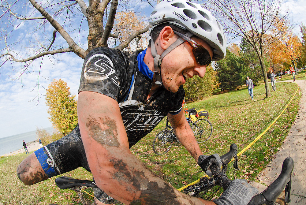 Greg Jackson leaps onto his bicycle after running up a section of stairs at the 2011 Euclid, Ohio cyclocross race.