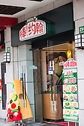 A sign for Papa Johns pizza fast food in Shanghai, China