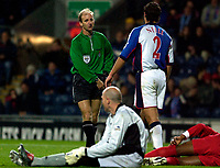 Photo. Jed Wee.<br /> Blackburn Rovers v Liverpool, Carling Cup, Ewood Park, Blackburn. 29/10/03.<br /> Blackburn's Lucas Neill (2) is shown the red card by referee Mike Riley.