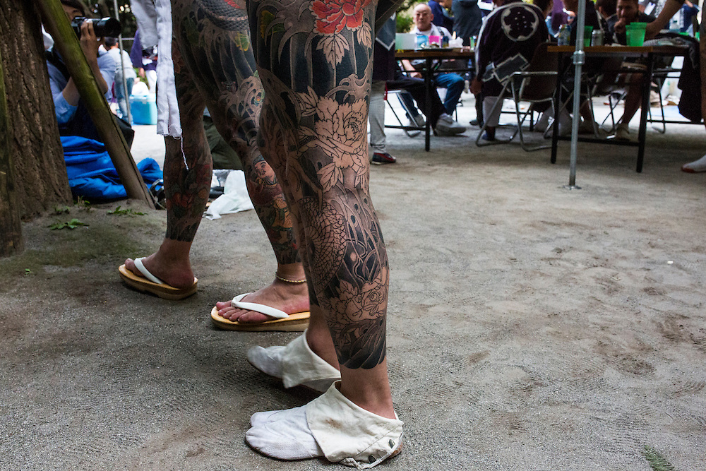 TOKYO, JAPAN - MAY 14: Yakuza gangsters proudly display their tattoos during the second day of the Sanja Matsuri Festival in Tokyo's Asakusa district on May 14, 2016. This festival is one of the rare times when members of the notorious Yakuza gang reveal themselves to public and take photo with festival goers.<br /> <br /> <br /> Photo: Richard Atrero de Guzman