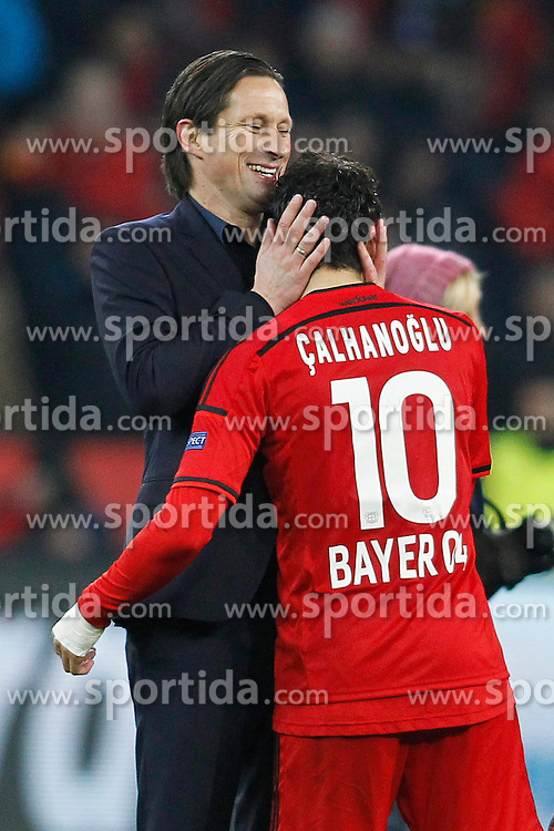 25.02.2015, BayArena, Leverkusen, GER, UEFA CL, Bayer 04 Leverkusen vs Atletico Madrid, Achtelfinale, Hinspiel, im Bild Trainer Roger Schmidt (Bayer 04 Leverkusen) umarmt Hakan Calhanoglu (Bayer 04 Leverkusen #10) nach dem Abpfiff // during the UEFA Champions League Round of 16, 1st Leg match between between Bayer 04 Leverkusen and Club Atletico de Madrid at the BayArena in Leverkusen, Germany on 2015/02/25. EXPA Pictures &copy; 2015, PhotoCredit: EXPA/ Eibner-Pressefoto/ Schueler<br /> <br /> *****ATTENTION - OUT of GER*****