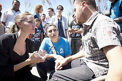 "UNHCR Special Envoy Angelina Jolie meets with Syrian refugees in Eastern Turkey, on September 13, 2012. The United Nations High Commissioner for Refugees, Antonio Guterres, and his Special Envoy, Angelina Jolie continued their regional tour visiting Turkey today, to hear accounts from Syrian refugees. On the third leg of a solidarity tour to support UNHCR's regional response to the Syrian refugee situation, the United Nations High Commissioner for Refugees Antonio Guterres, and his Special Envoy, Angelina Jolie spent the day visiting two of the 11 refugee camps along Turkey's border with Syria. The planning is for 17 camps to be established to enable Turkey to accommodate up to 36,000 more. Guterres and Jolie paid tribute to the Government of Turkey for keeping its borders open for anyone seeking asylum, adopting a system of temporary protection and providing assurance that no Syrian would be forcibly returned. ""Syrians have a history of welcoming people in need,"" added Ms. Jolie. ""Now it is their hour of need and I am grateful to Turkey, and all the neighboring countries for their extraordinary generosity."" During her visit to the camp, Ms. Jolie met with several families, all of whom had lost family members in the violence in Syria. One woman told her a story about a house that was bombed in her town and the entire family was killed. ""We don't care about our house,"" the woman said. ""We care about the blood of the people."" Another woman told her a similar story where a family was killed, but with one survivor - a baby found cradled in her dead mother's arms. Photo by UNHCR/J. Tanner by ABACAPRESS.COM"