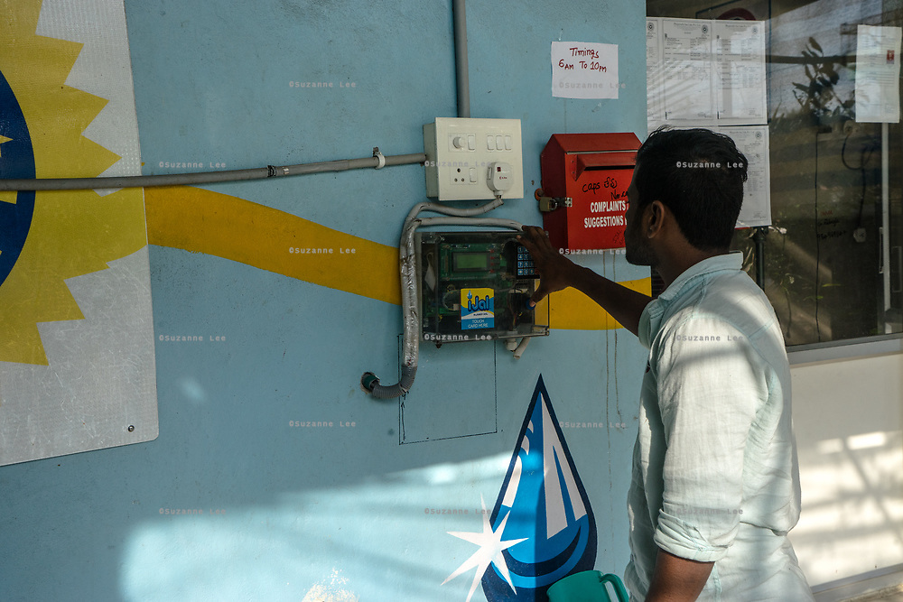 A customer uses a card to fill water can at a Safe Water Network iJal station in Rangsaipet, in Waragal, Telangana, Indiia, on Sunday, February 10, 2019. Photographer: Suzanne Lee for Safe Water Network