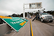 Road signs waiting to be installed prior to opening the new Self Anchored Suspension span of the bay bridge at the Treasure Island Tunnel during the closure of the Bay Bridge. Labor day bridge closure Thursday August 29, Friday August, 30, 2013. With ACC road crews.