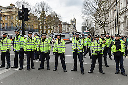 Metropolitan Police officers form a cordon at an anti-fascist demonstration against Pegida (Patriotic Europeans Against the Islamisation of the West) in Whitehall, London Feb 2016