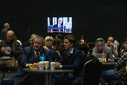 © Licensed to London News Pictures . 26/05/2019. Manchester, UK. People watch Michael Gove election programming on TV in a canteen at the count venue . The count for seats in the constituency of North West England in the European Parliamentary election , at Manchester Central convention centre . Photo credit: Joel Goodman/LNP
